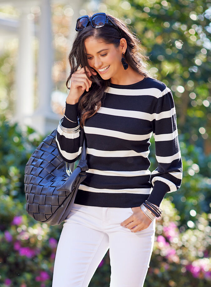 Here's to warmer days ahead. Shop Sweaters